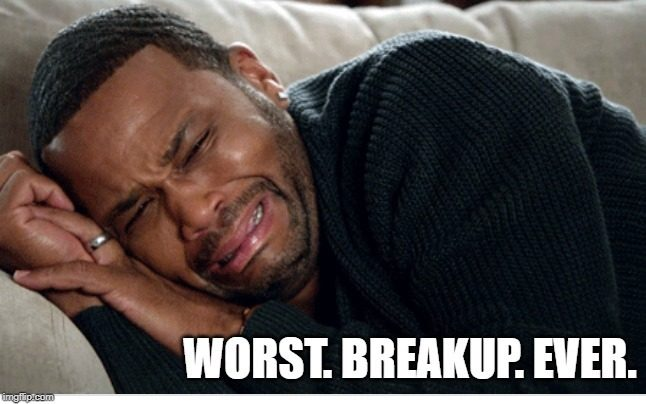 Man crying on the bed with caption: worst breakup ever