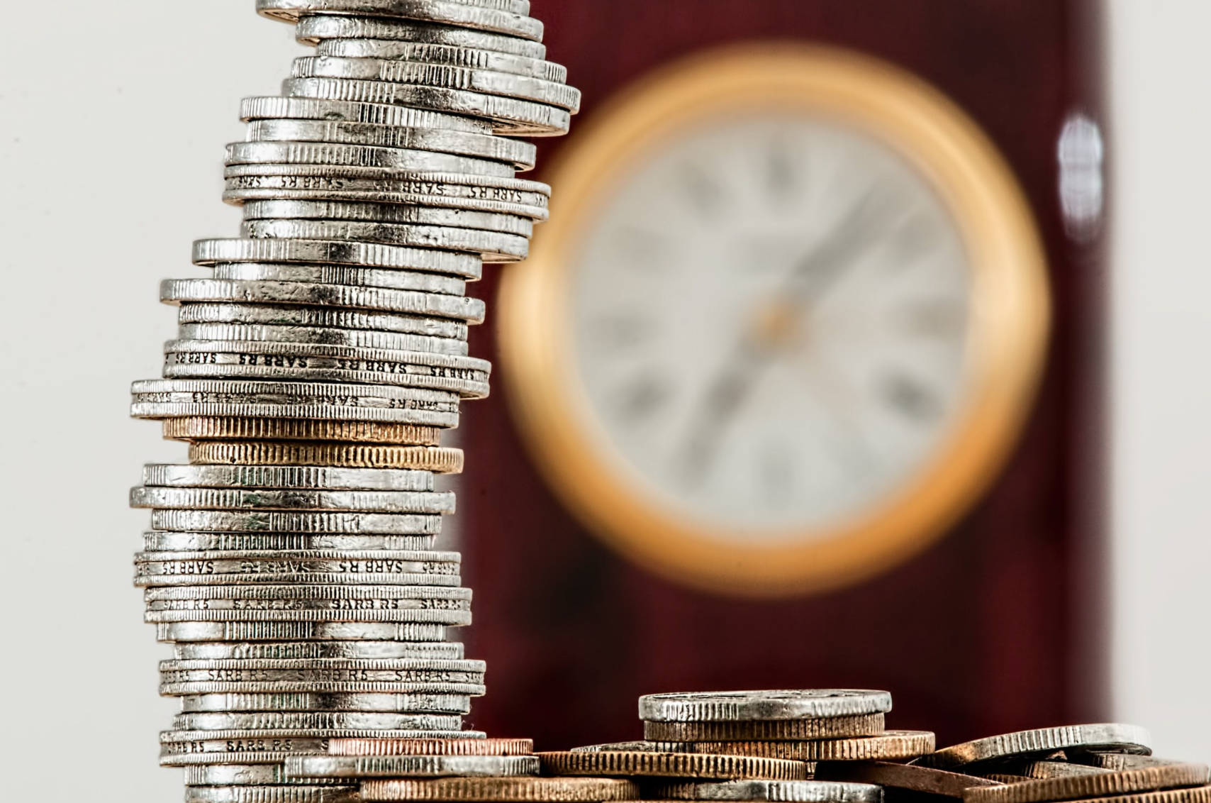 an image of coins and clock